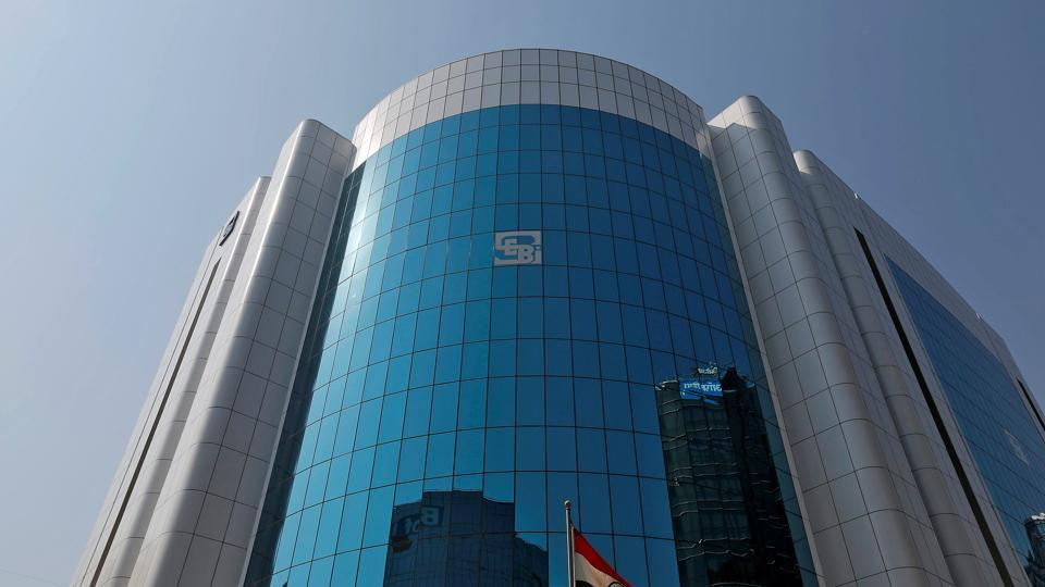 The logo of the Securities and Exchange Board of India (SEBI) is seen on the facade of its headquarters building in Mumbai, India.