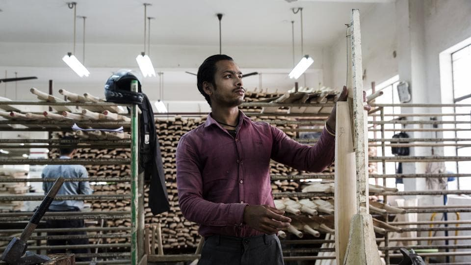 With the 2018 Indian Premier League knocking, a worker measures the length of an unfinished cricket bat at Sanspareils Greenlands (SG), in Meerut, Uttar Pradesh. From their cricket balls and bats to protective equipment, clothing, ground equipment and accessories used across sporting disciplines, Sanspareils Greenlands has been a legendary name in Indian sporting gear. (Udit Kulshrestha / Bloomberg)