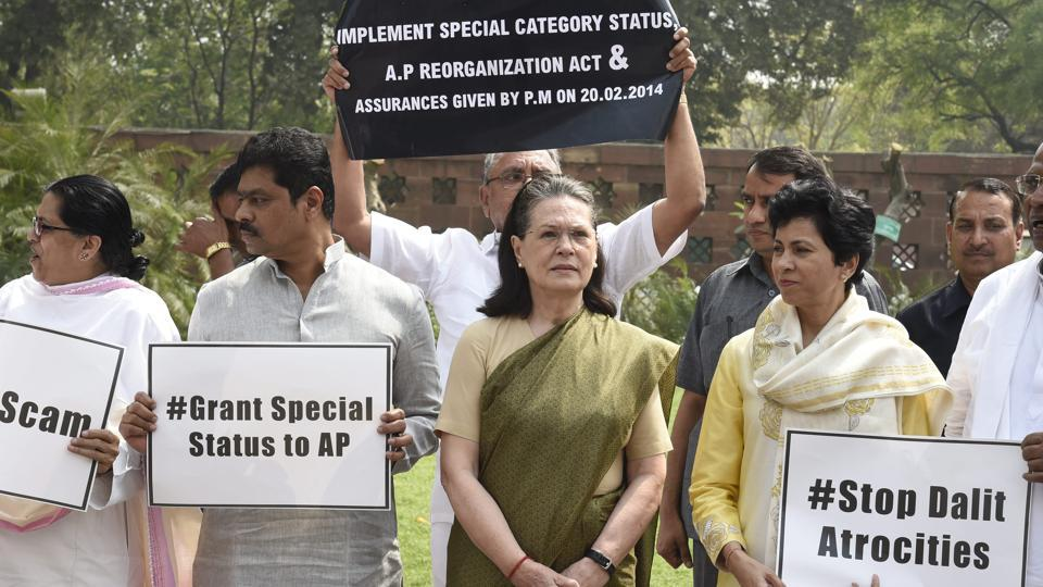 Congress president Rahul Gandhi and UPA chairperson Sonia Gandhi along with members of opposition parties led a protest outside the Parliament on Thursday against various issues such as the farmer crisis, bank scam, no-confidence motion, SC/ST Protection Act and disinvestment of Air India among others. (PTI)