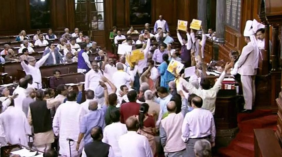Opposition members protest infront of Rajya Sabha chairperson M Venkaiah Naidu during the on-going budget session of Rajya Sabha, at Parliament House in New Delhi on Wednesday.
