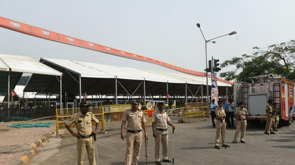 Cops assemble outside MMRDA grounds. While the party holds foundation day celebrations every year, this show, a year ahead of the polls, was aimed at showcasing its growth in the past four years and energising its cadre. (satyabrata tripathy/HT photo)
