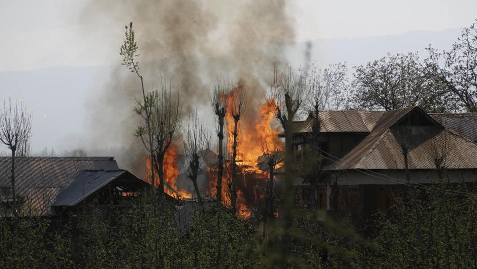 Residential buildings are seen up in flames during a gun battle between suspected militants and security forces in Shopian, Srinagar on April 01, 2018. (Mukhtar Khan / AP)
