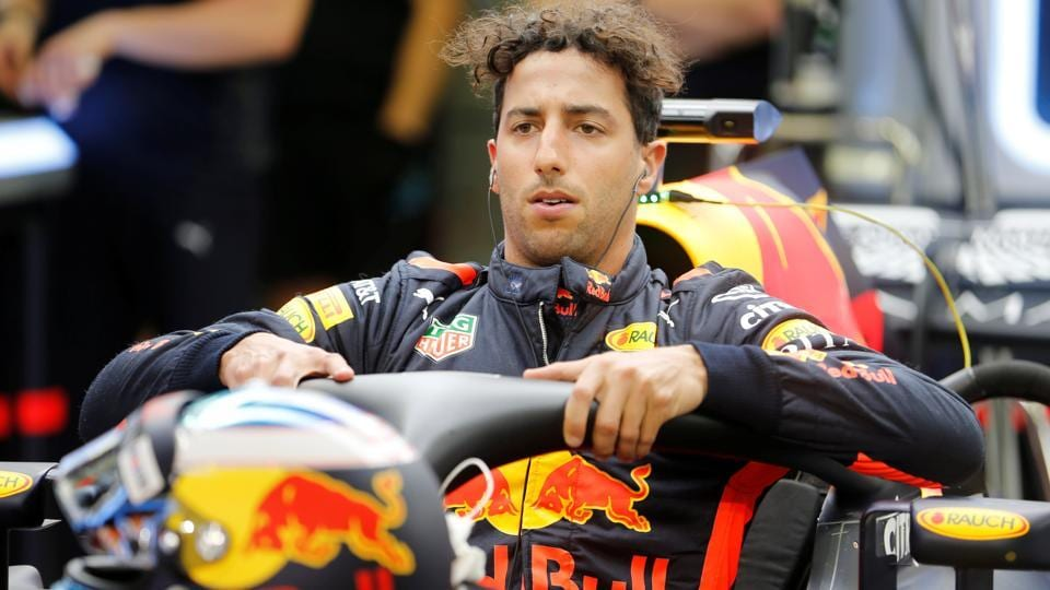 Red Bull's Daniel Ricciardo beat Mercedes and Ferrari to set the fastest time in first practice at the Bahrain Grand Prix.