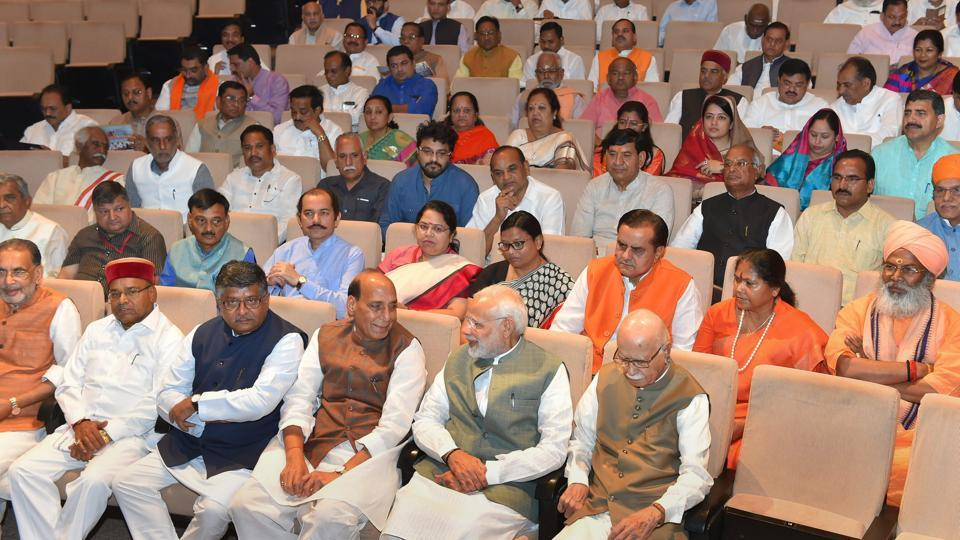 Prime Minister Narendra Modi with senior BJP leader L K Advani, Union Home Minister Rajnath Singh and other members during BJP parliamentary party meeting in New Delhi on Friday. (Vijay Verma / PTI)