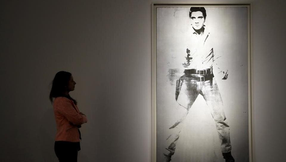 A painting by Andy Warhol called 'Double Elvis [Ferus Type]' (1963) is displayed at Christie's auction rooms in London.