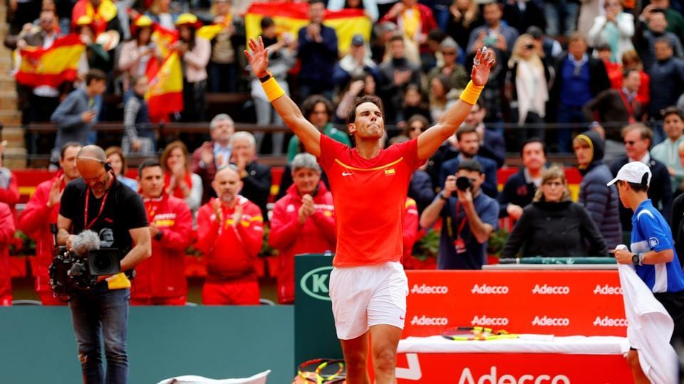 Rafael Nadal on Friday won his first match since limping out of the Australian Open in January when he beat Germanys Philipp Kohlschreiber in straight sets in the Davis Cup quarter-finals.