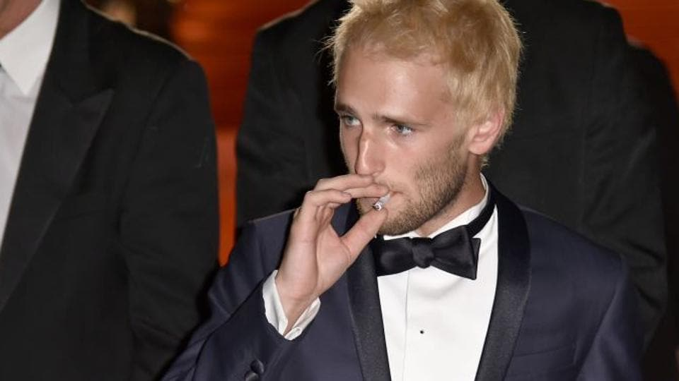 US actor Hopper Jack Penn, who has been arrested for possession of drugs , is seen smoking a cigarette after the screening of The Last Face at the 69th Cannes Film Festival in Cannes, southern France.