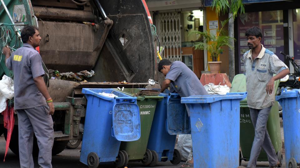 Civic workers segregate waste in Vashi.