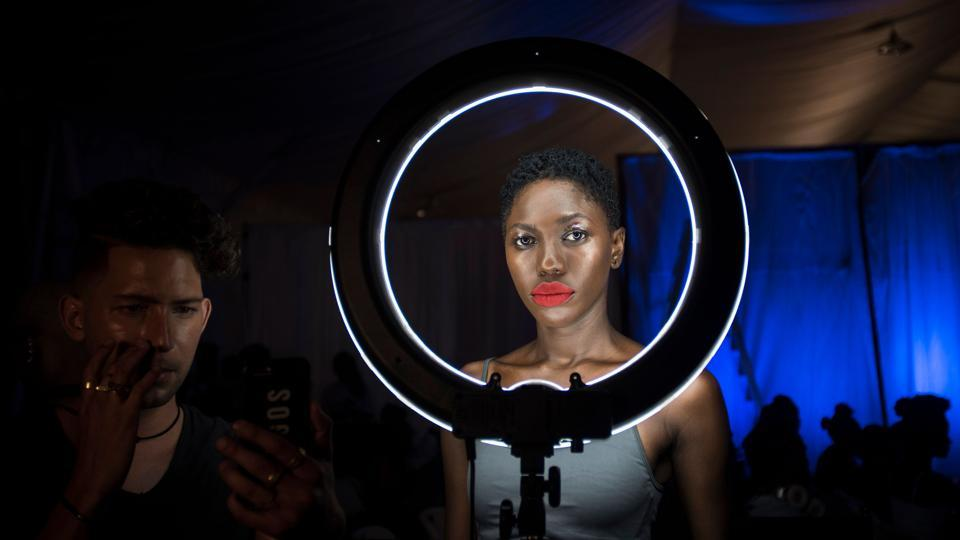 A model prepares backstage during the Accra Fashion Week in Accra, Ghana. (Cristina Aldehuela / AFP)