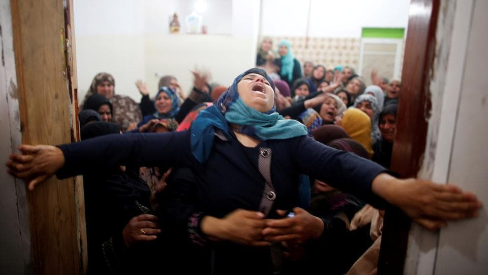Mourners hold back a relative of Palestinian Hamdan Abu Amshah, who was killed along Israel border with Gaza, during his funeral in Beit Hanoun town, in the northern Gaza Strip. (Suhaib Salem / REUTERS)