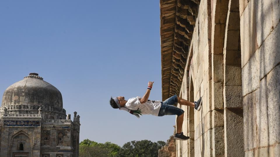 Uday Al Ajramy scales up a wall at the Lodhi Gardens in New Delhi. Parkour and free running, adapted from military obstacle courses, run on the philosophy of finding one's own way through complex urban environments with speed and efficiency. Free Run Gaza are among the Middle East's leading practitioners of this urban sport and its most famous Palestinian export. (Burhaan Kinu / HT Photo)