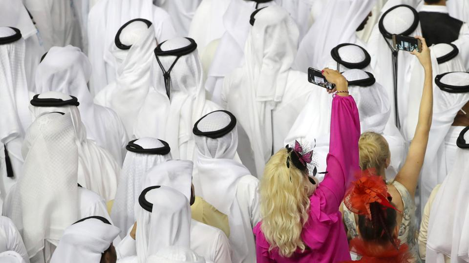 Fans attend the trophy presentation in the Meydan Racecourse in Dubai, United Arab Emirates. (Karim Sahib / AFP)