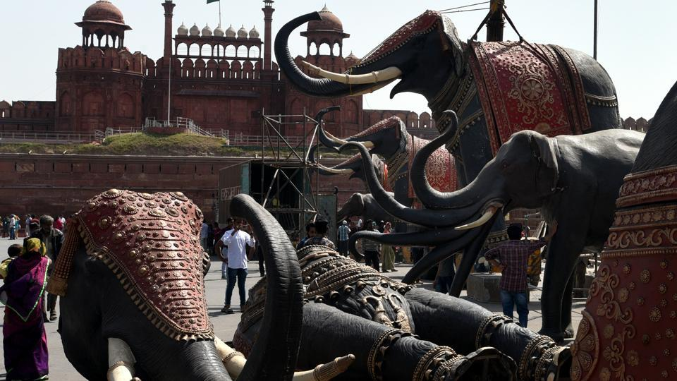 Workers dismantle elephant sculptures placed outside Red fort after BJP's Rashtriya Raksha Yagna event to secure victory in 2019 Lok Sabha elections.