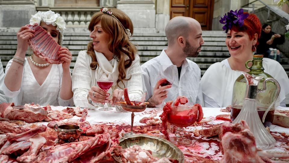 Activists of the 269 Animal freedom, a anti-speciesism association, parody the Christian Last Supper during a demonstration in Lausanne, Switzerland. (Fabrice Coffrini / AFP)