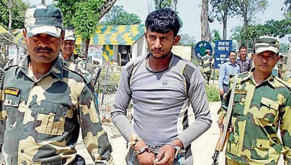 Border Security Force men with the arrested Pakistani smuggler Sabar Hussain in Amritsar on Friday.