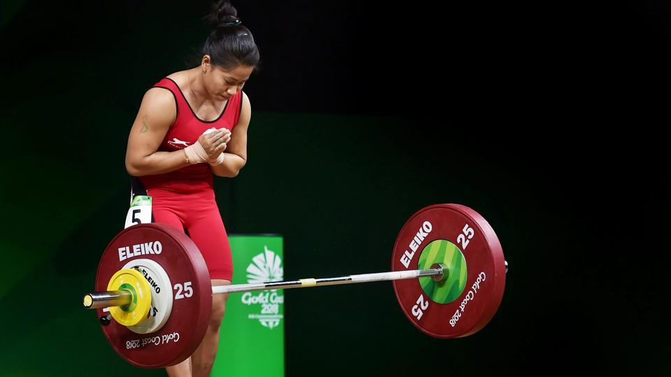 Sanjita Chanu celebrates a Commonwealth Games record in women's 48kg weightlifting during the Commonwealth Games 2018 in Gold Coast, Australia on April 05, 2018. Chanu claimed India's second gold medal at the Games, winning the top spot in the women's 53kg category as well. (Manvender Vashist / PTI)