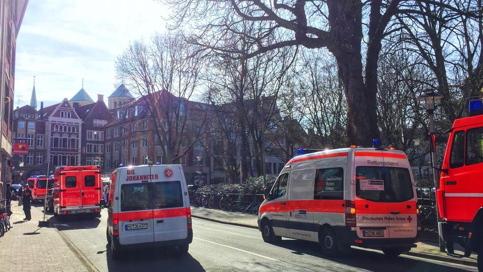 First responders work at the scene when several people were killed and injured when a car ploughed into pedestrians in Muenster, western Germany on April 7, 2018.
