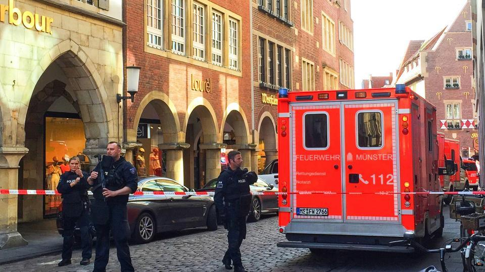 Police and first responders work at the scene when several people were killed and injured when a car ploughed into pedestrians in Muenster, western Germany on April 7, 2018.