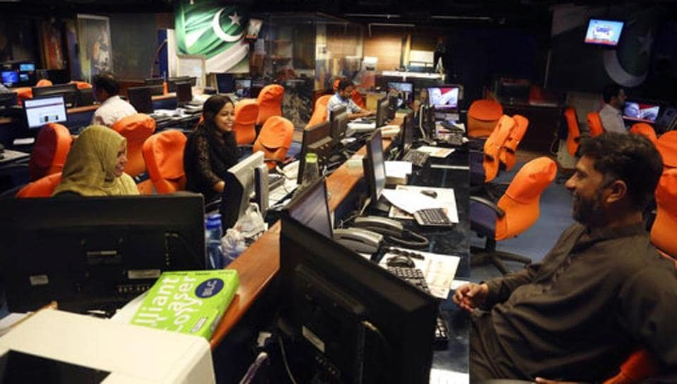Staff of Pakistani channel Geo News work in their control room in Karachi.