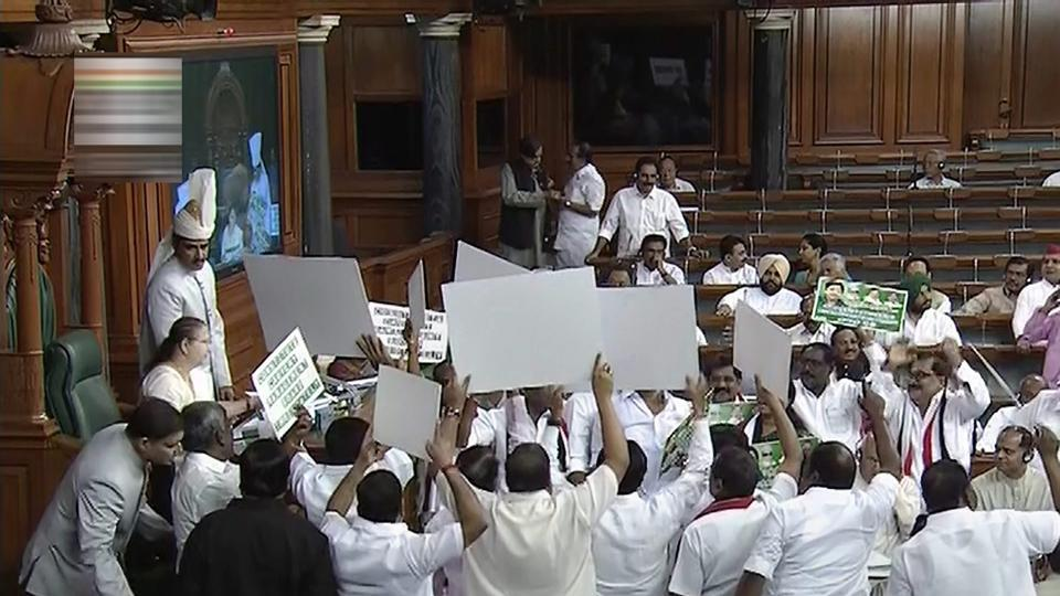 Opposition members protest on the last day of the Budget session in the Lok Sabha, in New Delhi on Friday. The second half of the Parliament's Budget session ended in a washout as both Houses were adjourned indefinitely without transacting any legislative business. The session, which began on March 5, was among the least productive in the last 18 years. (PTI)