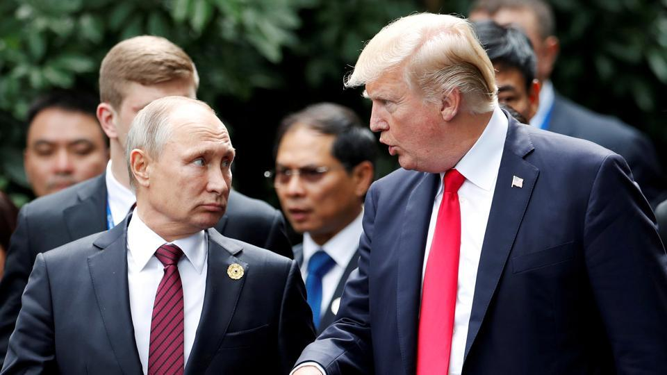 US President Donald Trump and Russia's President Vladimir Putin talk during the family photo session at the APEC Summit in Danang, Vietnam, November 11, 2017.