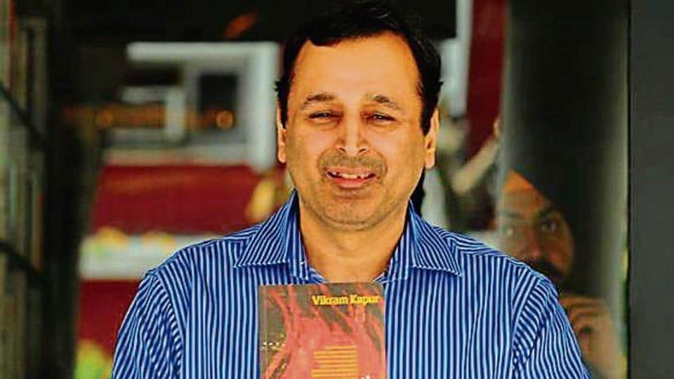 The author Vikram Kapur with his novel in Chandigarh on Saturday.