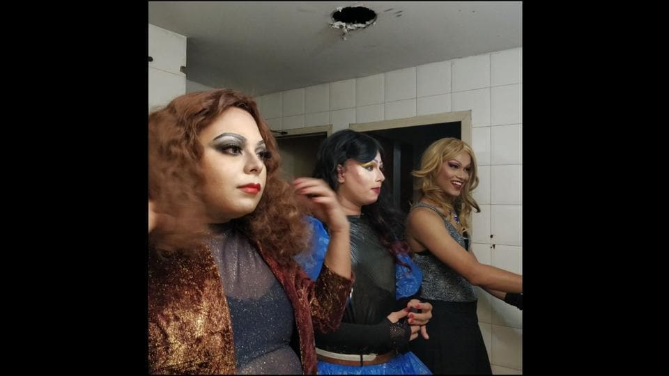 Drag artists Lush, Kush and Betta seen changing into their costumes in the washroom of Tis Hazari metro station, Delhi. The queens, however call themselves sisters-- unified by their distinct characters, large-size eyelashes, self-stitched outfits with sequins. Many perform for free so as to garner a larger audience, making more people aware of what they do.  (HT Photo)