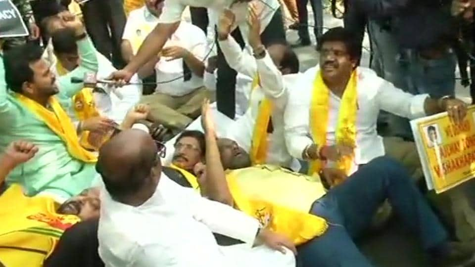 TDP MPs protest outside Prime Minister's residence at Lok Kalyan Marg over demand of special category status for Andhra Pradesh on Sunday.