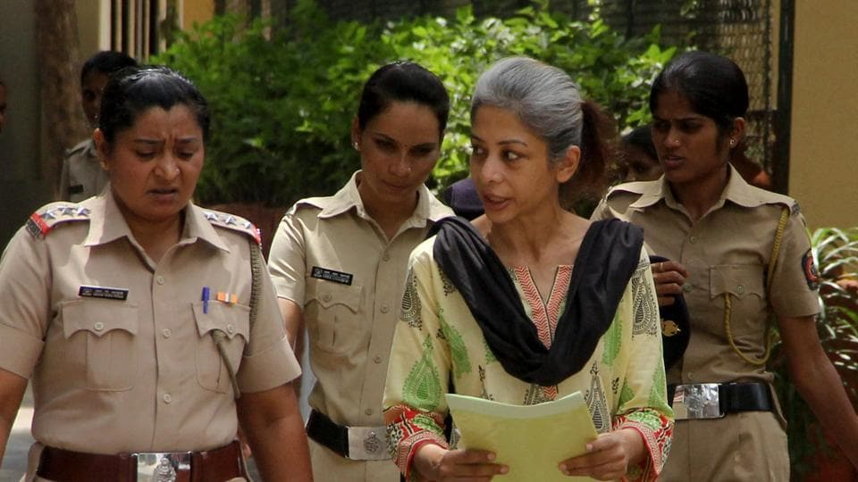 Indrani Mukerjea, an accused in Sheena Bora murder case, being taken to sessions court in Mumbai.