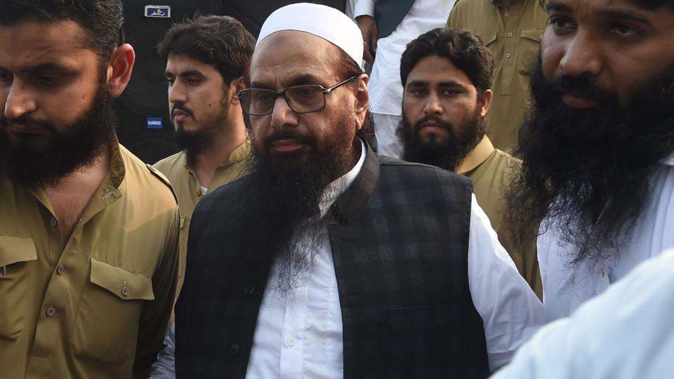 Hafiz Saeed (centre) at a protest rally in Lahore on April 6, 2018.  The USdeclared Saeed's Jamaat-ud-Dawa (JuD) a foreign terrorist organisation by the US in June 2014.