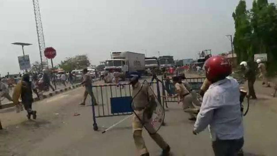 Police chasing  away agitating truck drivers at the Mahadipur land port in Malda district  in Bengal on Monday.