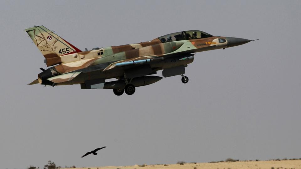 An Israeli F-16 fighter jet takes off from Ramon air base in southern Israel during routine training on October 21, 2013.