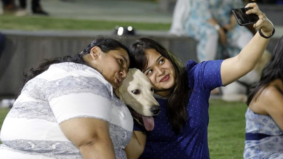 Pet-lovers taking a selfie and capturing the moment at the PetYo festival Pune 2018 at Amanora Club House in Pune on April 8. (RAHUL RAUT/HT PHOTO)