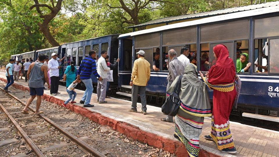 Passengers on the train are often surprised at how the compact 2-ft narrow gauge heritage train manages to chug uphill on its scenic route. Large windows provide wide views of the valleys on either side and passengers can hop on and off at the stations along the route. (Pratham Gokhale / HT Photo)
