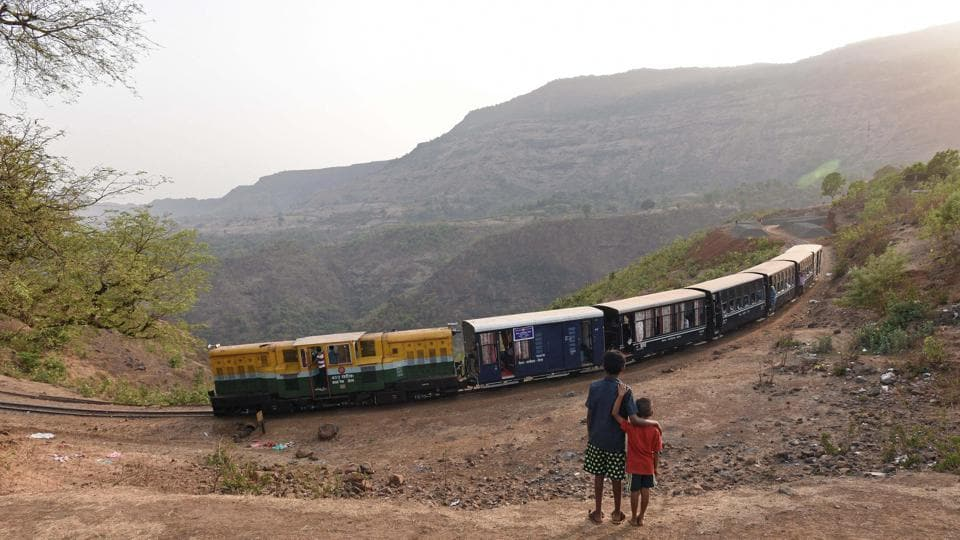 Children look on as a toy train makes its way from Jummapatti. Work is underway on replacing the tracks and putting up safety barriers around the riskier turns and crossings. And keeping with the demand, authorities are looking at increasing services, and also perhaps a dining car. (Pratham Gokhale / HT Photo)