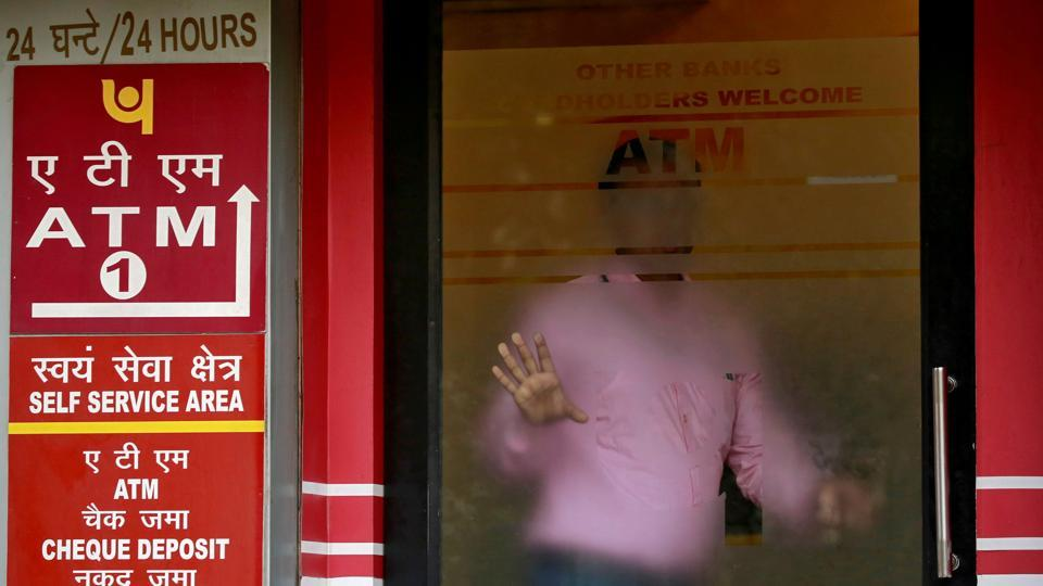 A man leaves an automated teller machine (ATM) facility of Punjab National Bank (PNB) in New Delhi.