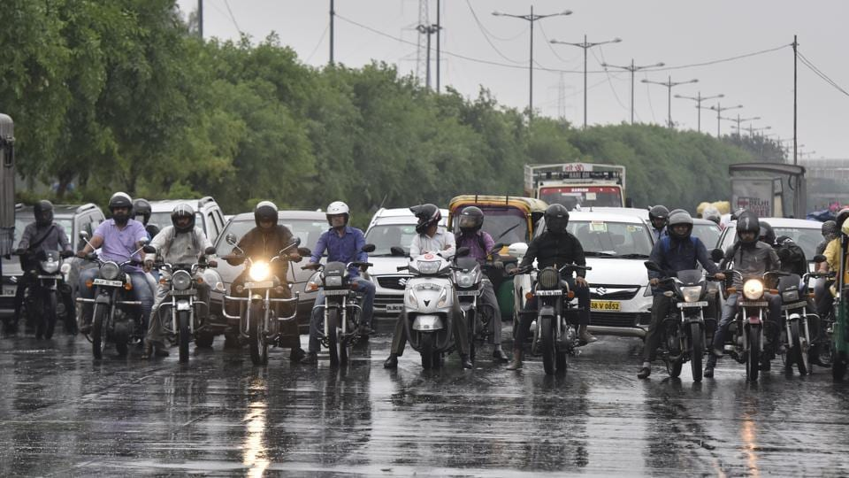 New Delhi, India- April 9, 2018: Commuters during light rain in the capital near Geeta Colony, India on Monday morning, April 09, 2018. ( Photo by Sonu Mehta/ Hindustan Times)