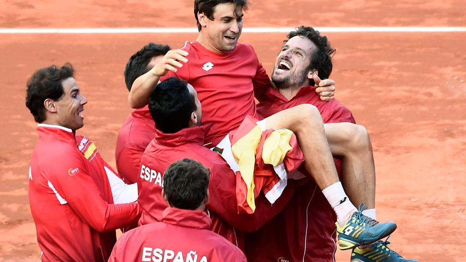 Spain's David Ferrer is carried by Rafael Nadal and teammates as they celebrate after beating Germany in the Davis Cup quarterfinal tennis tie at the bullring of Valencia on Sunday.