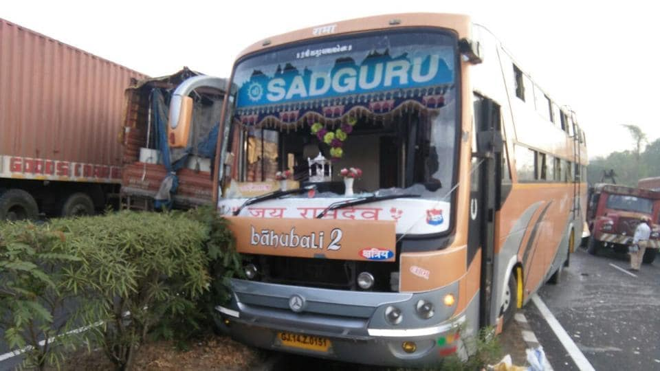 The bus was parked on the side of the road owing to a punctured tyre when the container rammed into it.