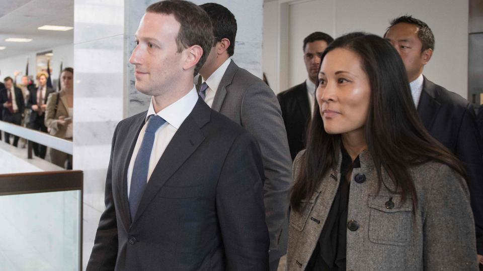 Facebook chief executive Mark Zuckerberg and his executive assistant Andrea Besmehn depart US Senator Bill Nelson's, D-Florida, office on Capitol Hill in Washington DC on Tuesday.