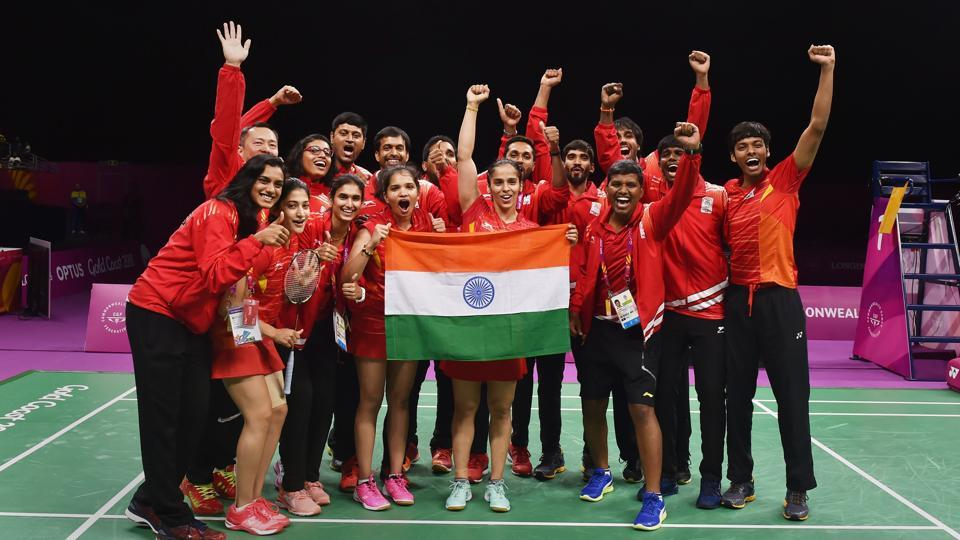 The Indian badminton team poses with the tricolour celebrating their mixed-team badminton final win at Commonwealth Games (CWG) 2018 in Gold Coast, Australia. Despite some good singles players, India had never won the team event at the Commonwealth Games. But on Monday, India set right that anomaly as the team defeated Malaysia 3-1 in the final to win gold. (Manvender Vashist / PTI)