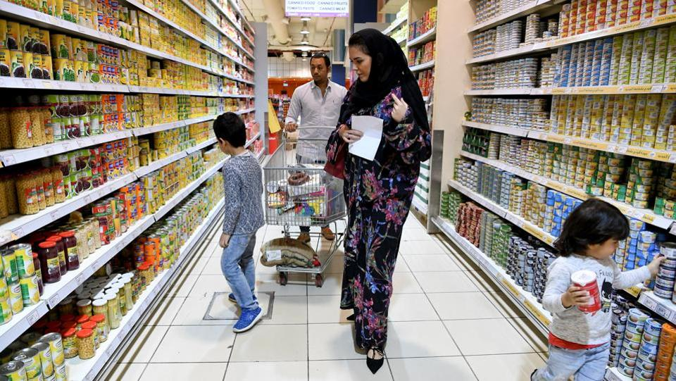 Amirah al-Turkistani, shops with her family at a supermarket in Jeddah. On the bike, the 30-year-old still wears an abaya, the loose-fitting, full-length robe, required public dress for Saudi women. But instead of traditional black, she chooses from a range of pastels she designed herself, trimmed with lace and sporting patches of bright colours. (Reem Baeshen / REUTERS)
