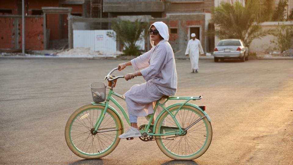 When Amirah al-Turkistani left Boston in 2015 after a graduate degree, friends mocked her decision to ship her beloved pistachio-coloured bicycle back home to Saudi Arabia. Riding in public was unthinkable then in the deeply conservative Muslim kingdom, where religious police patrolled public spaces to enforce modest dress, bans on music and alcohol, prayer-time store closures and the mixing of unrelated men and women. (Reem Baeshen / REUTERS)