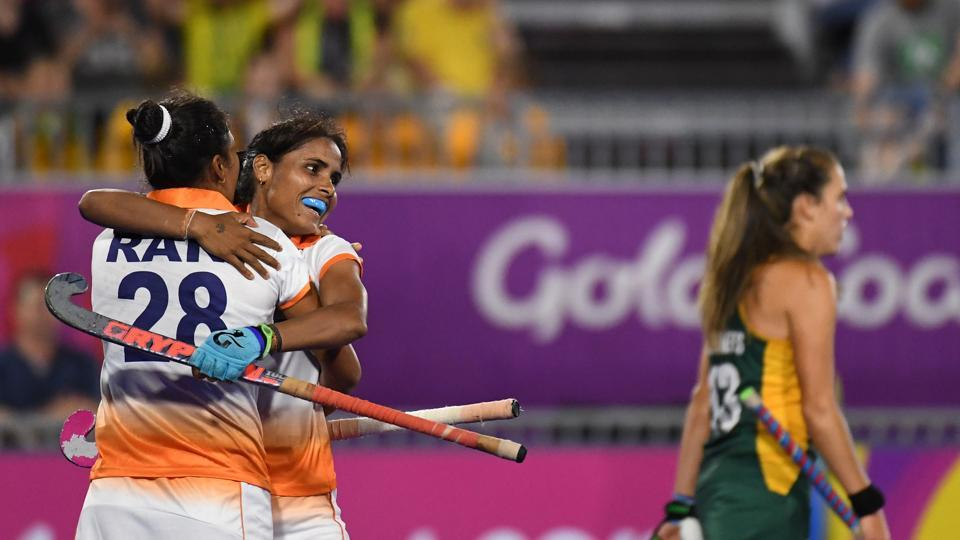 Rani of India (L) is congratulated by teammate Vandana Katariya after scoring a goal during the women's field hockey match between India and South Africa. India won the match 1-0.  (AFP)