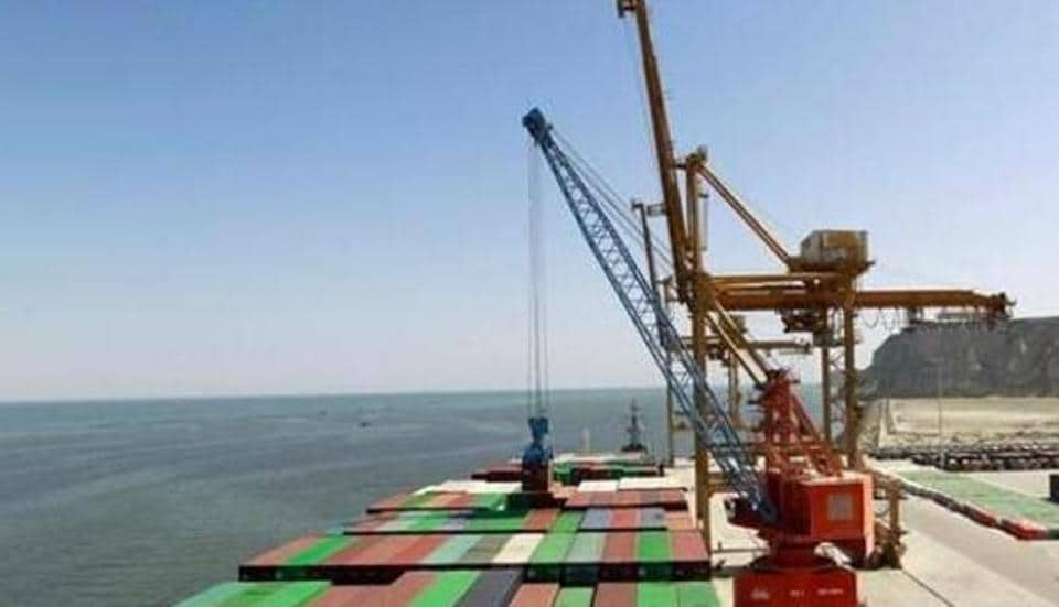 A container is loaded on to the Cosco Wellington, the first container ship to depart after the inauguration of the China Pakistan Economic Corridor port in Gwadar, Pakistan, in 2016 .