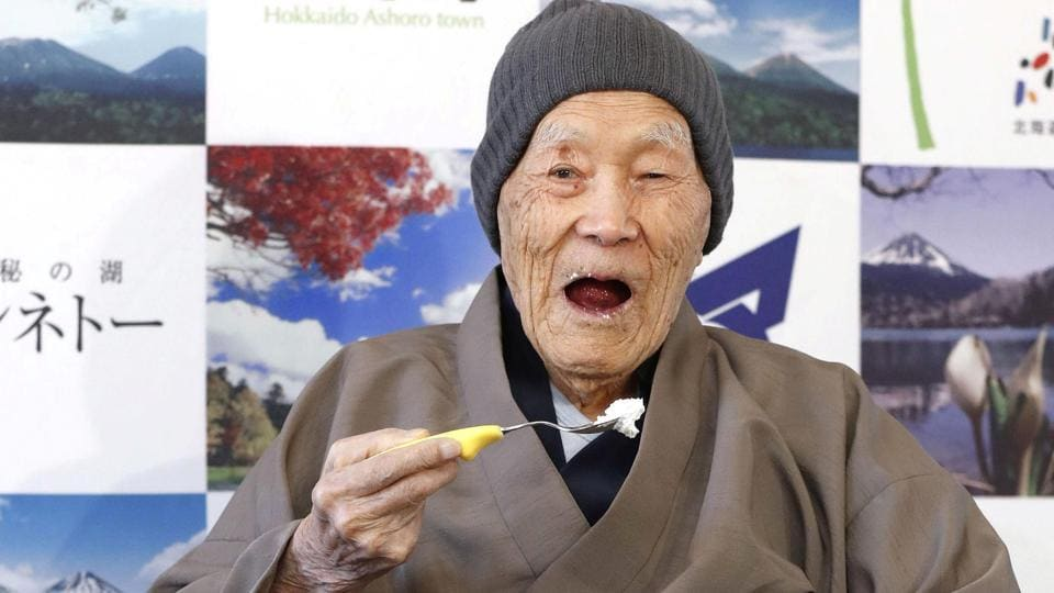 Japanese Masazo Nonaka, who was born 112 years and 259 days ago, eats his favourite cake as he receives a Guinness World Records certificate naming him the world's oldest man during a ceremony in Ashoro, Japan.