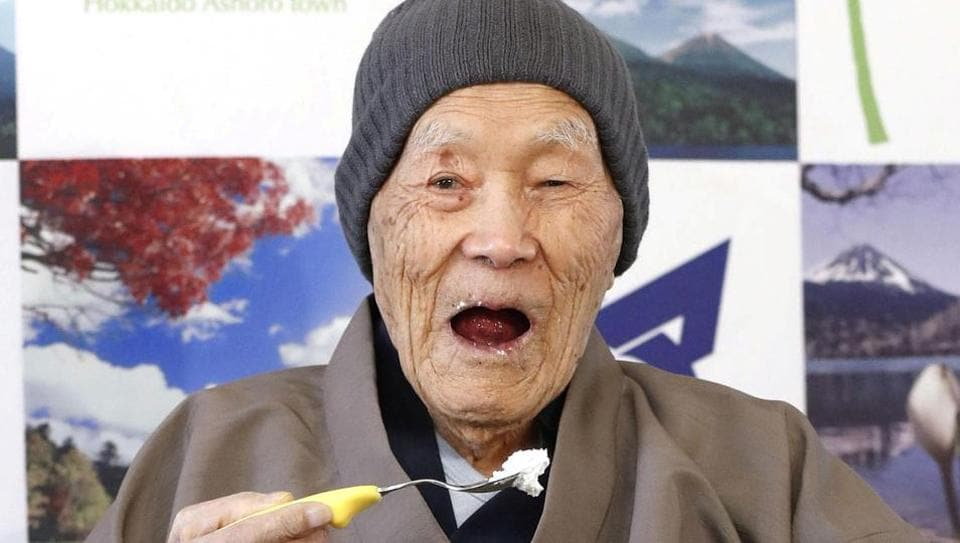 Japanese Masazo Nonaka, who is 112 years old, eats his favourite cake as he receives a Guinness World Records certificate naming him the world's oldest man during a ceremony in Ashoro on Monday.
