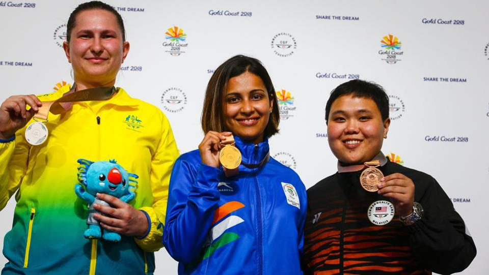 (L to R) Silver medallist Australia's Elena Galiabovitch, gold medallist India's Heena Sidhu and bronze medallist Malaysia's Alia Sazana Azahari on the podium at the awards ceremony following the women's 25m pistol shooting final.  (AFP)