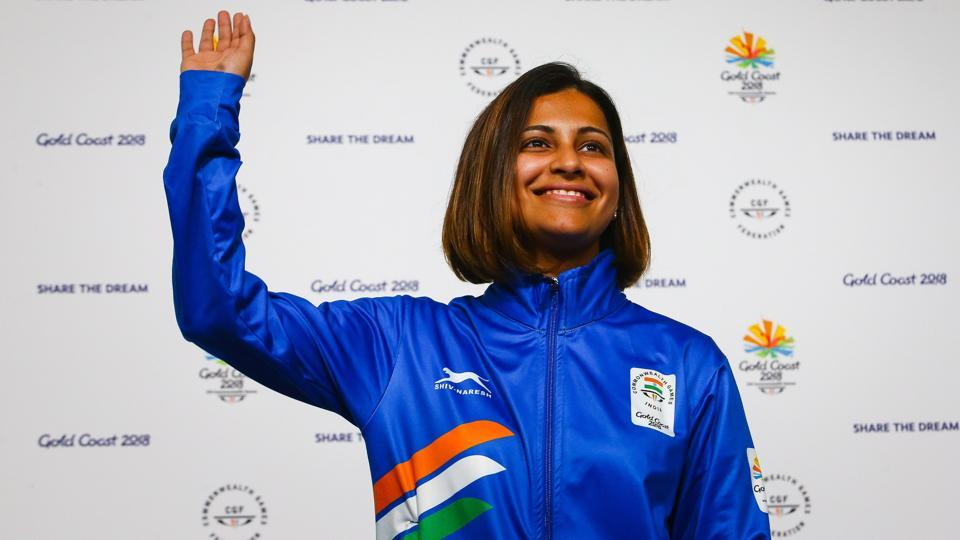 India's Heena Sidhu waves from the podium at the awards ceremony following her victory in the women's 25m pistol shooting during the 2018 Gold Coast Commonwealth Games at the Belmont Shooting Complex in Brisbane on April 9, 2018.  (AFP)