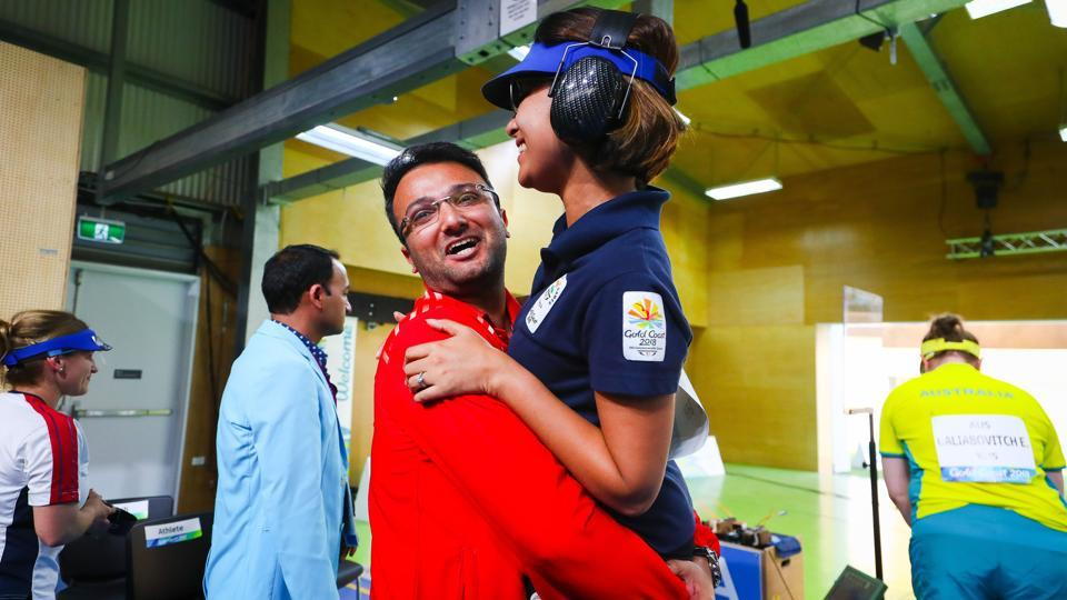 India's Heena Sidhu is hugged by her coach and husband Ronak Pandit following the women's 25m pistol shooting final. Sidhu won the gold by shattering a Games record.  (AFP)